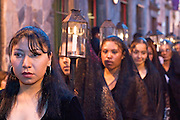 09 APRIL 2004 - SAN MIGUEL DE ALLENDE, GUANAJUATO, MEXICO: Women dressed in black and carrying lanterns from Iglesia Oratorio participate in the church Good Friday procession in San Miguel de Allende, GTO, MEX. The Good Friday procession from Oratorio is one of the most ornate in Mexico. The dignitaries, whose role in the procession is handed down from father to son and mother to daughter, accompany the procession carrying tall lantern and statues representing aspects of the life of Christ. Semana Santa, the week before Easter, is celebrated with extreme piety in central Mexico. San Miguel, which was founded in the 1600s, is one of Mexico's premier colonial cities. It has very strict zoning and building codes meant to preserve the historic nature of the city center. About 7,500 US citizens, mostly retirees, live in San Miguel. PHOTO BY JACK KURTZ