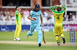 England's Chris Woakes avoids being run-out during the ICC Cricket World Cup group stage match at Lord's, London.
