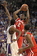 Nebraska guard Joe McCray (2) looks to make a pass to Husker Jason Dourisseau (lower right) agaisnt pressure from Kansas State's Akeem Wright in the first half.  The Huskers defeated K-State 57-42 at Bramlage Coliseum in Manhattan, Kansas, January 11, 2006.