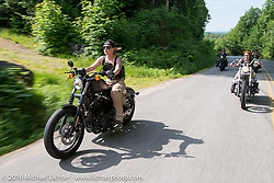 Dana Cooley of the Iron Lilies out riding during Laconia Motorcycle Week 2016. NH, USA. Sunday, June 19, 2016.  Photography ©2016 Michael Lichter.