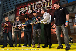 Harley-Davidson head of motorcycle design Ray Drea presents a special Harley-Davidson award at the Annual Mooneyes Yokohama Hot Rod and Custom Show. Japan. Sunday, December 7, 2014. Photograph ©2014 Michael Lichter.