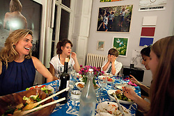 Left to right, Pamela Bell laughs with children Lenore Simotas, 16, Will Simotas, 11, nanny Ana Kayne and Anabel Simotas, 14, at their home in New York, N.Y., Sept. 16, 2011.