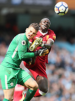 Ederson of Manchester City collides with Sadio Mane of Liverpool lduring the premier league match at the Etihad Stadium, Manchester. Picture date 9th September 2017. <br /> Norway only