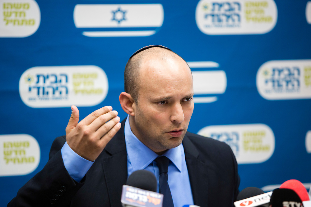 Israel's Minister of Economics, Industry, Trade and Labor and Minister of Religious Services and leader of the Jewish Home party Naftali Bennett speaks during a Jewish Home faction meeting at the Knesset, Israel's parliament in Jerusalem, on October 27, 2014.