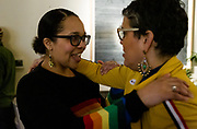 Ali Muldrow speaks with Ananda Mirilli after they saw their victorious results during the Madison School Board election watch party at Robinia Courtyard in Madison, Wisconsin, Tuesday, Feb. 19, 2019.