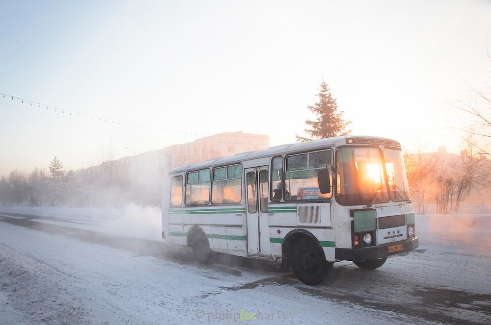 Bus driving through the town of Tynda, Amur region. Siberia, Russia