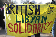 British resident Libyan exiles protest outside their London embassy.