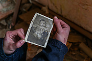 An Armenian resident shows an old picture of a baby he found in the Rubbles of an abandoned house that is left by the Spitak Earthquake which struck 33 years ago. On Sunday, Jan 16, 2021, I visited the city which lies close to the epicentre of 1988 devastating Armenia quake, some 100 km (62 miles) north of the capital Yerevan. Spitak was entirely destroyed during the devastating earthquake, which is now rebuilt in a slightly different location. The earthquake that devastated Armenia in December 1988 killed 25,000 people and leaving half a million homeless. Like the tsunami that devastated southern Asia 16 years later, it focused the world's sympathy for unspeakable suffering and unleashed an outpouring of aid. (Photo/ Vudi Xhymshiti)
