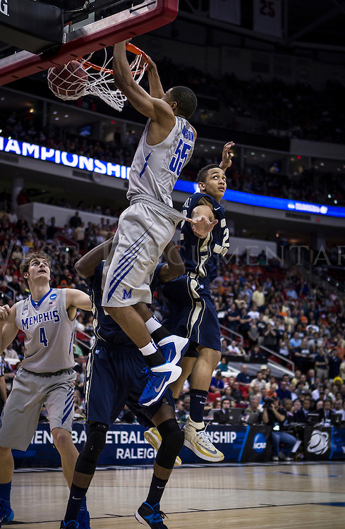 Memphis Tigers guard Geron Johnson (55) jams the ball in the basket at PNC Arena on March 21 during the NCAA Men's Division I Championship games.