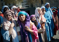 © London News Pictures. 06/04/2012. London, UK.  Actors perform The Passion of Jesus  in front of thousands of people in Trafalgar Square in central London, England on  April 6, 2012  to mark Good Friday. The actors come from the Wintershall Estate in Surrey. Photo credit :  Ben Cawthra/LNP
