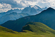 Marmolada (Ladin: Marmoleda, German: Marmolata, 3343 meters / 10,968 feet elevation) is the highest mountain in the Dolomites, or Dolomiti, a part of the Southern Limestone Alps, in northern Italy, Europe. The view looks westwards from a trail west of Gasthaus Passo di Giau. The Dolomites are honored as a natural World Heritage Site (2009) by UNESCO.