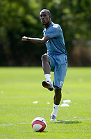 Photo: Daniel Hambury.<br /> West Ham United Media Day. 10/08/2006.<br /> Carlton Cole passes the ball during training.