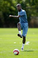 Photo: Daniel Hambury.<br /> West Ham United Media Day. 10/08/2006.<br /> Carlton Cole passes the ball during training.