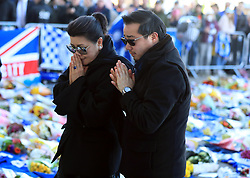 Aiyawatt Srivaddhanaprabha son of Leicester Chairman lays a wreath in memory of his father with his mother Aimon. Vichai Srivaddhanaprabha, was among those to have tragically lost their lives on Saturday evening when a helicopter carrying him and four other people crashed outside King Power Stadium.