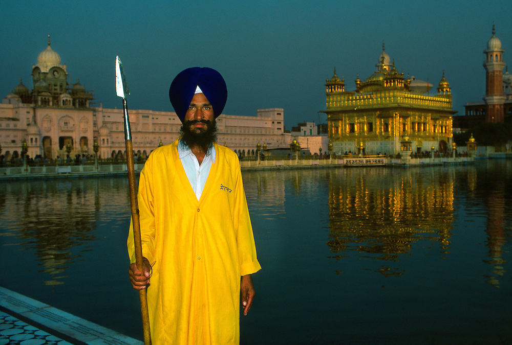 Sikh guarding the Golden Temple (holiest Sikh shrine), Amritsar, Punjab, India
