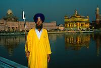 Sikh guarding the Golden Temple (holiest Sikh shrine), Amritsar, Punjab, India