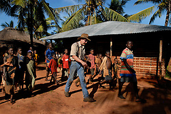 """Dairen Simpson, also known as """"Bwana Simba"""" or """"Mr. Lion"""" looks for lion prints in the village of Navanga, Tanzania. Ami Vitale"""