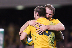 © Licensed to London News Pictures. 16/06/2012. Etihad Stadium, Melbourne Australia. Wallaby Rob Horne is hugged by teammate Pat McCabe after scoring try during the 2nd Rugby Test between Australia Wallabies Vs Wales . Photo credit : Asanka Brendon Ratnayake/LNP