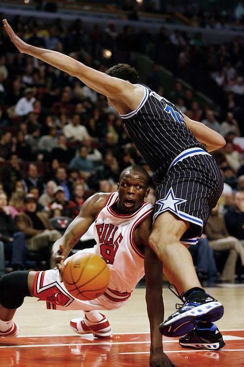 NBA Basketball, Chicago Bulls vs Orlando Magic.Chicago's Luol Deng (9), left, with Orlando's Hedo Turkoglu (15)..