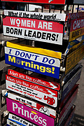Joke bumper stickers for sale at Southend-on-sea, Essex. The town could be described as run down as while there are some signs of affluence, these are few and far between. The predominant atmosphere is quite rough feeling and quite poor. Southend is a seaside resort that is very popular with people from the East side of London due to it's close proximity, just an hour away by train along the Thames Gateway. With the decline of seaside resorts, from the 1960s much of the centre was developed for commerce and many of the original features were destroyed through redevelopment or neglect.