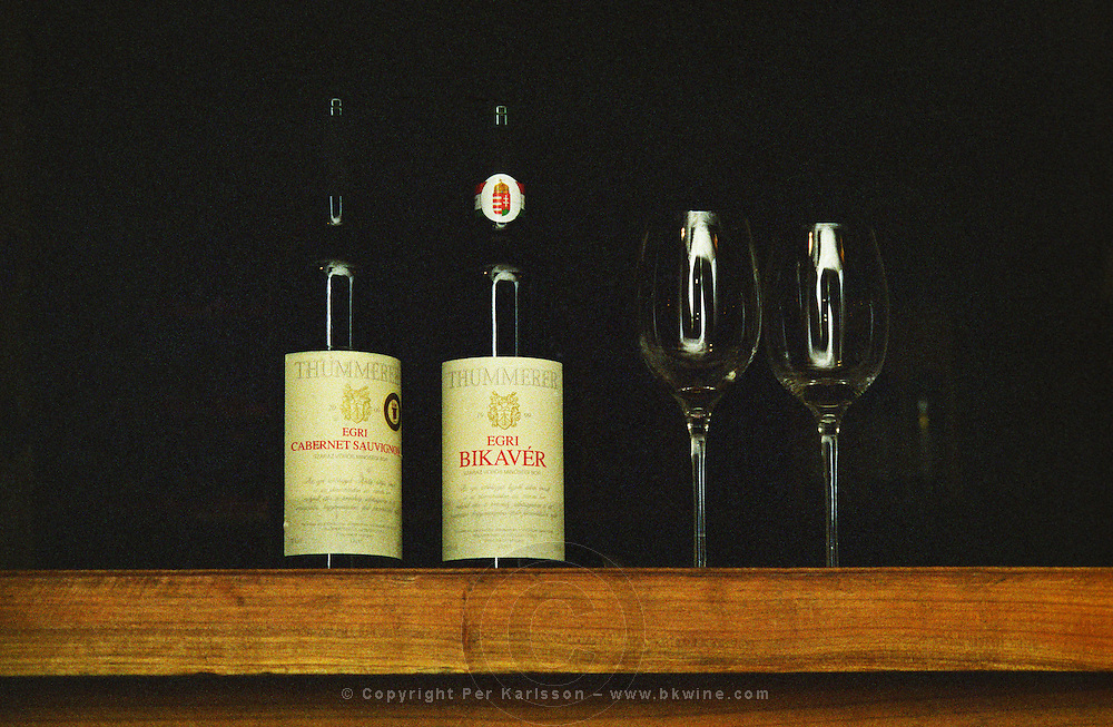 At the Thummerer winery: bottles with Egri Cabernet Sauvignon and Egri Bikaver, with tasting glasses. Thummerer is one of the leading growers and wine makers in Eger.