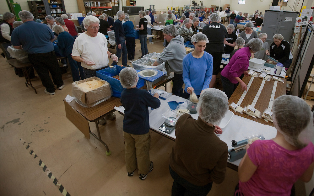 An estimated 600 volunteers participated in packaging meals for Feed My Starving Children over several packing sessions like this one. Feed My Starving Children is Christian organization based in Minnesota that helps feed starving children around the world. Meals are packaged by volunteers and paid for through donations. FMSC has four permanent packaging sites but also a mobile pack program. Here, a mobile pack site uses the facilities at Portal Industries in Grafton.