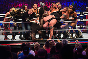 Shaquille O'Neal and The Big Show are pushed out of the ring during a 20-man battle royal during WrestleMania on April 3, 2016 in Arlington, Texas.