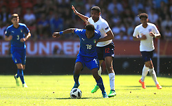 England U17's Vontae Daley-Campbell (right) and Italy U17's Jean Freddi Pascal Greco (centre) battle for the ball during the UEFA European U17 Championship, Group A match at Banks's Stadium, Walsall.