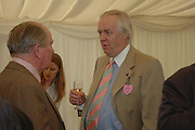 Sir Tim Rice. Ludlow Charity Race Day,  in aid of Action Medical Research. Ludlow racecourse. 24 march 2005. ONE TIME USE ONLY - DO NOT ARCHIVE  © Copyright Photograph by Dafydd Jones 66 Stockwell Park Rd. London SW9 0DA Tel 020 7733 0108 www.dafjones.com