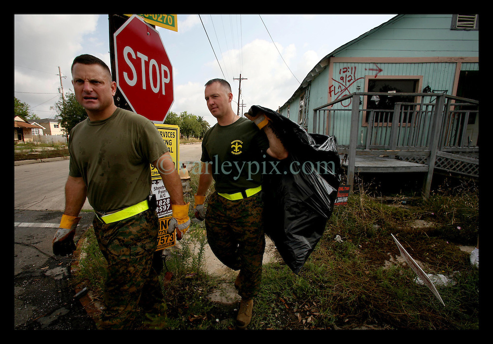 May 5th, 2006. New Orleans, Louisiana. Lower 9th ward. Eight  months after hurricane Katrina and marines from Marine Force Reserve G4 volunteer to pick up trash in the devastated neighbourhoods.