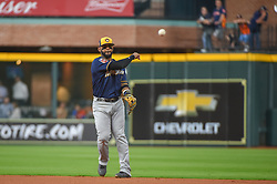 March 26, 2018 - Houston, TX, U.S. - HOUSTON, TX - MARCH 26: Milwaukee Brewers infielder Jonathan Villar (5) makes a play at first during the game between the Milwaukee Brewers and Houston Astros at Minute Maid Park on March 26, 2018 in Houston, Texas. (Photo by Ken Murray/Icon Sportswire) (Credit Image: © Ken Murray/Icon SMI via ZUMA Press)