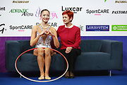Minagawa Kaho here sitting on Kiss and Cry at World Cup Pesaro 2018. She was born 20 August, 1997 in Chiba Prefecture, Japan.