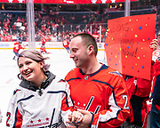 Lifelong Washington Capitals fans Mark and Ryn celebrate their five-year anniversary by officially tying the knot during warmups at Capital One Arena on February 20, 2020.