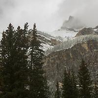 An early snowfall dusts Cascade Mountain in Alberta , Canada's Banff National Park.