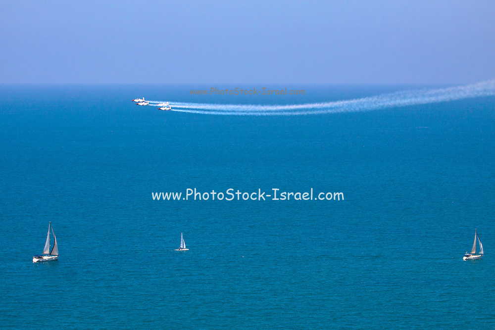 Israeli Air force (IAF) Flight Academy Beechcraft T-6A Texan II aerobatics team during a display over the Mediterranean Sea
