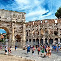 Rome. Italy. View of the well preserved Arch of Constantine (Arco di Constantino) which is a triumphal arch situated beside the Colosseum.  It was erected in 315 AD to honour Constantine's victory over co-emperor Maxentius at the Battle of Milvian Bridge on October 28, 312 AD. Most of the reliefs on the war memorial were taken from older buildings from previous centuries which were probably disused and demolished.