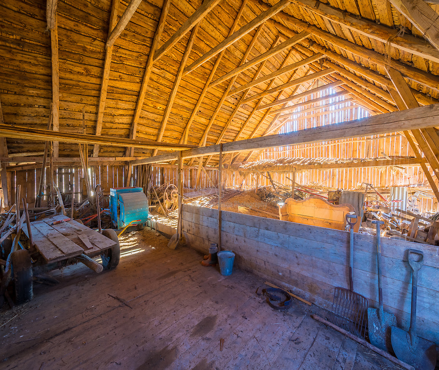 Hay loft in old barn in Sweden. A hayloft is a space above a barn, stable or cow-shed, traditionally used for storage of hay or other fodder for the animals below. Haylofts were used mainly before the widespread use of very large hay bales, which allow simpler handling of bulk hay.