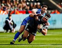 Scott Baldwin of Ospreys is tackled by dr10/<br /> <br /> Photographer Simon King/Replay Images<br /> <br /> Guinness PRO14 Round 18 - Ospreys v Dragons - Saturday 23rd March 2019 - Liberty Stadium - Swansea<br /> <br /> World Copyright © Replay Images . All rights reserved. info@replayimages.co.uk - http://replayimages.co.uk