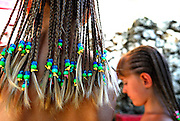 Two Australian children tourists (9 years old and 6 years old) with their hair braided. Sanur, Bali, Indonesia