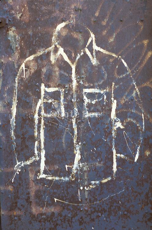 graffiti drawing of shirt on rusty door
