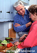 Active Aging Senior Citizens, Retired, Activities, Elderly Happily Retired at Home, Relaxed in Home Romance in the Kitchen, Food Prep. Couple Prepares Food at Home