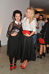 Left to right, LULU GUINNESS and MARISSA MONTGOMERY at the launch of The Lulu Perspective to celebrate 25 years of Lulu Guinness held at 74a Newman Street, London on 13th September 2014.