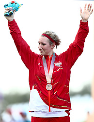 England's Hayley Simmonds celebrates with her bronze medal won in the Women's Individual Time Trial during the Women's Individual Time Trial at Currumbin Beachfront during day six of the 2018 Commonwealth Games in the Gold Coast, Australia.