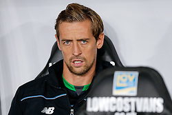 Peter Crouch of Stoke City looks on from the bench - Mandatory byline: Rogan Thomson/JMP - 07966 386802 - 19/10/2015 - FOOTBALL - Liberty Stadium - Swansea, Wales - Swansea City v Stoke City - Barclays Premier League.
