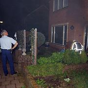 Woningbrand Frans Halslaan 19 Huizen, rookontwikkeling, politie, voordeur