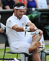 Tennis - 2017 Wimbledon Championships - Week One, Friday [Day Five]<br /> <br /> Mens Singles Third Round match<br /> Andy Murray (GBR) v Fabio Fognini (ITA) <br /> <br /> Fabio Fognini changes his socks  on Centre court <br /> <br /> COLORSPORT/ANDREW COWIE