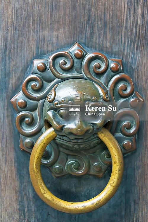 Lion knocker on the door of traditional building, Yuyuan Garden, Shanghai, China