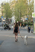 """April, 9th 2020 - Paris, Ile-de-France, France: Parisians walking dogs and exercising in the hope of protecting themselves from the spread of the Coronavirus, during the first month of near total lockdown imposed in France. A week after President of France, Emmanuel Macron, said the citizens must stay at home for at least 15 days, that has been extended. He said """"We are at war, a public health war, certainly but we are at war, against an invisible and elusive enemy"""". All journeys outside the home unless justified for essential professional or health reasons are outlawed. Anyone flouting the new regulations is fined. Nigel Dickinson"""