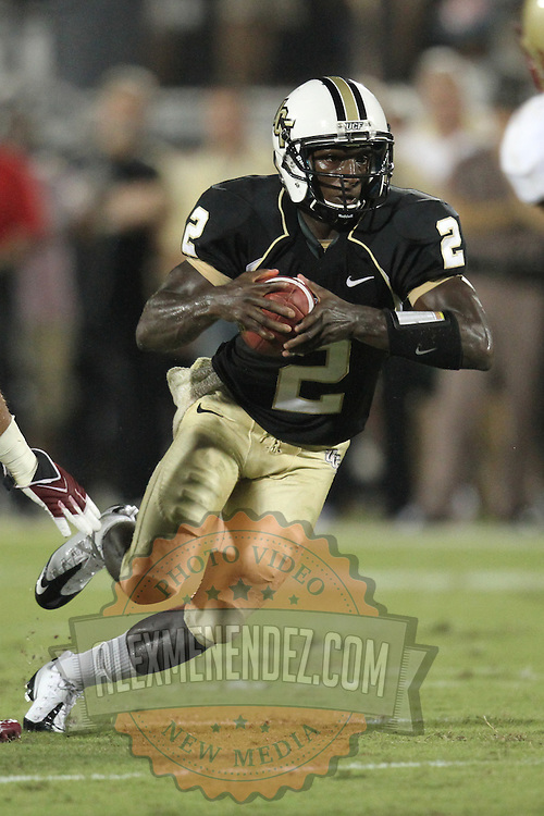 Central Florida quarterback Jeff Godfrey (2) runs during an NCAA football game between the Boston College Eagles and the UCF Knights at Bright House Networks Stadium on Saturday, September 10, 2011 in Orlando, Florida. (AP Photo/Alex Menendez)