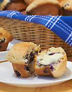 Blueberry muffins on a wooden table on the patio. Outdoor food scene for carole jones commercial photography portfolio